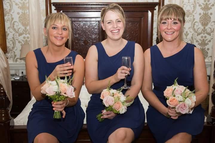 Bridesmaid handled wedding flowers by Rugeley Florist - Rugeley Floral Studio Fine Flowers