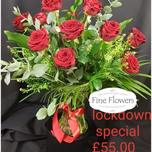 12 Red Roses with mixed-foliages in a vase