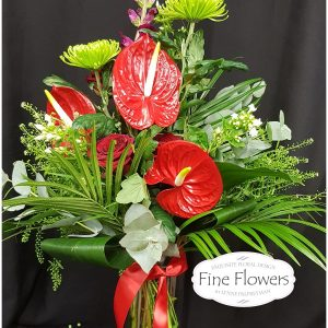 Exotic Anthurium with Antirrinhum, shamrock blooms,3xRed Roses,with mixed foliages.presented in a vase