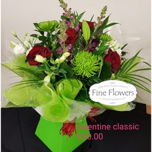 Handtied of Red Roses, Green Blooms, Lisianthus, Lily and Antirrunhum with mixed flowers boxed in water.