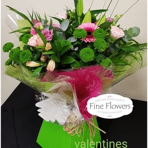 Handtied of Pink Lisianthus, Green Santini, Pink Carnation, Pink Gerbera, Lily and mixed foliages boxed.