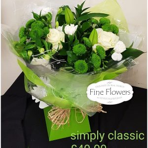 Handtied whites and green includes White Rose, Lily, Alstromeria, Santini with mixed foliages boxed in water.