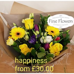 Handtied including yellow gerbera, yellow roses, purple tulips, lisianthus, mixed foliages.