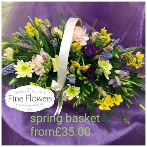 Spring flower basket includes. Hyacinths, daffodils, lisianthus, freesia with mixed foliages.